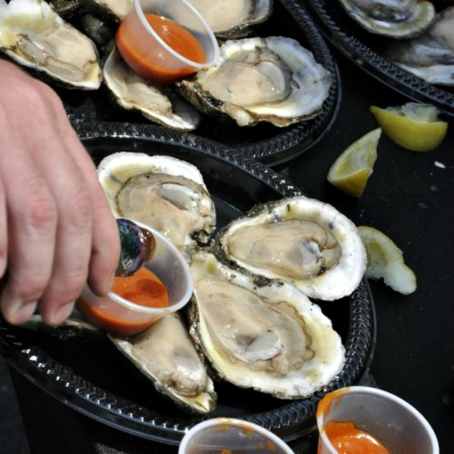Acme Oysters served with hot sauce