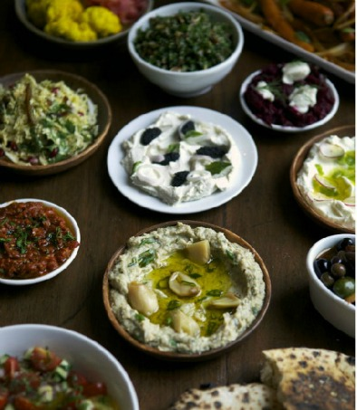 An assortment of dips served with hot, fresh pita bread straight out of the brick oven